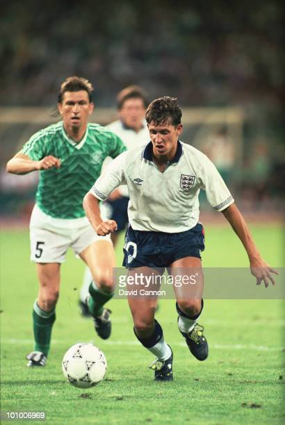 Klaus Augenthaler of the Federal Republic of Germany looks on as Gary Lineker of England goes past him during the FIFA World Cup Finals 1990...