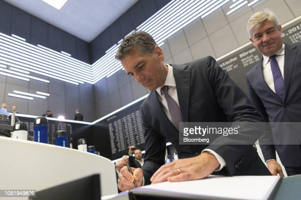 Klaus Deller chief executive officer of KnorrBremse AG signs a guest book as the company makes its initial public offering at the Frankfurt Stock...