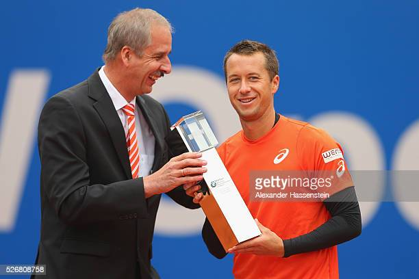 Klaus Draeger board member of BMW group hands over the winners trophy to Philipp Kohlschreiber of Germany after winning his finale match against...