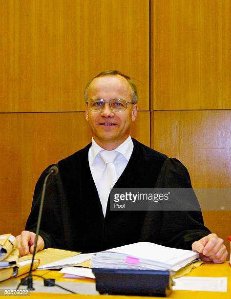 Klaus Drescher residing judge in Armin Meiwes' retrial attends the court session on January 12 2006 at the District Court in Frankfurt Germany Meiwes...