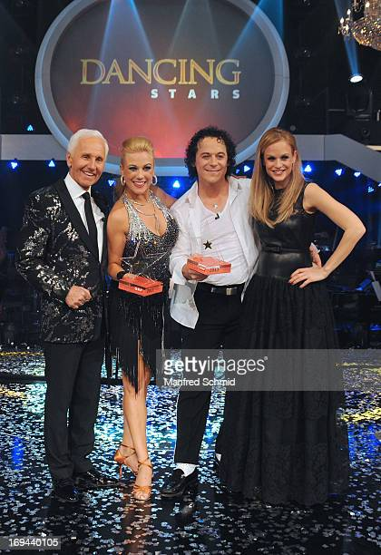 Klaus Eberhartinger, Manuela Stoeckl, Rainer Schoenfelder and Mirjam Weichselbraun pose for a photograph during the final of the TV Show 'Dancing...