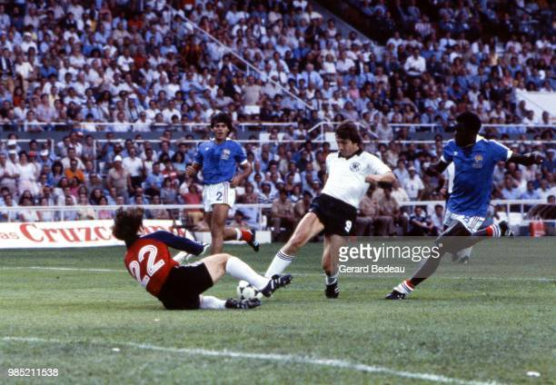 Klaus Fischer of West Germany FRG and Jean luc Ettori of France during the semi final match between France and FRG Sevilla Spain on July 8th 1982