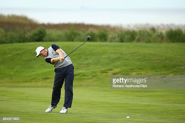 Klaus Ganter of Europe plays into the 9th green in his match with Vince van Veen against Haydn McCullen and Jamie Dick of GBI during the first day of...