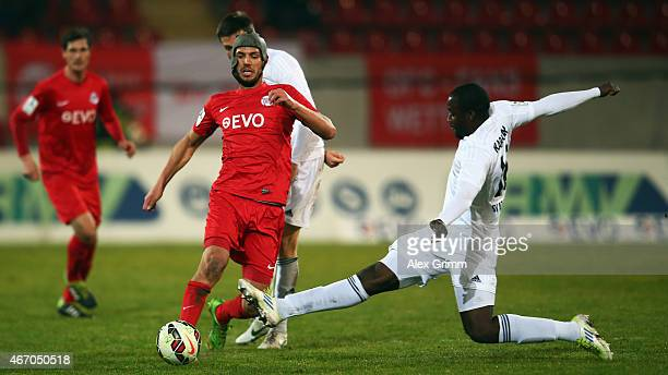 Klaus Gjasula of Offenbach is challenged by Jerry Opoku-Karikari of Elversberg during the Regionalliga West match between Kickers Offenbach and SV...