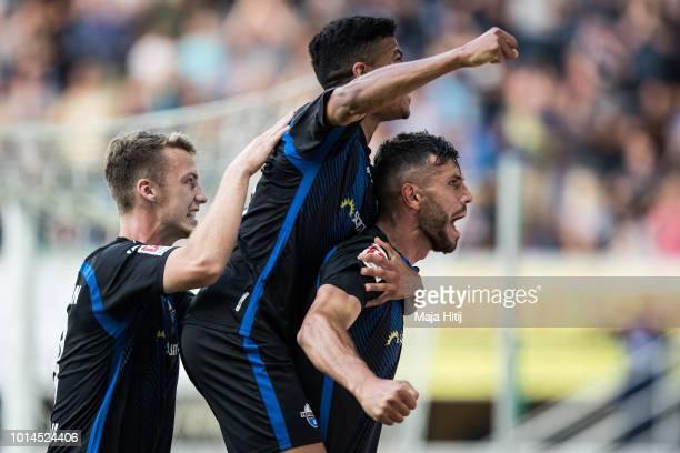 Klaus Gjasula of SC Paderborn celebrates with his teammates after scoring his teams first goal to make it 10 during the Second Bundesliga match...
