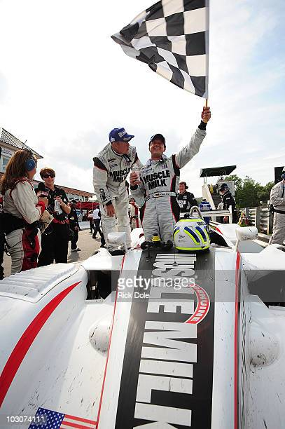 Klaus Graf of Germany and Greg Pickett of the United States drivers of the Mucsle Milke Team Cytosport Porsche RS Spyder celebrate their victory of...