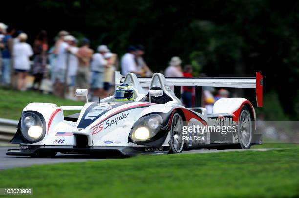 Klaus Graf of Germany drives the Muscle Milk Team Cytosport Porsche RS Spyder to victory with codriver Greg Pickett during the American Le Mans...