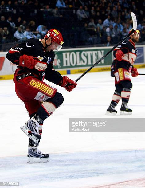 Klaus Kathan of Hannover celebrates after scoring his team's first goal during the DEL match between Hamburg Freezers and Hannover Scorpions at the...