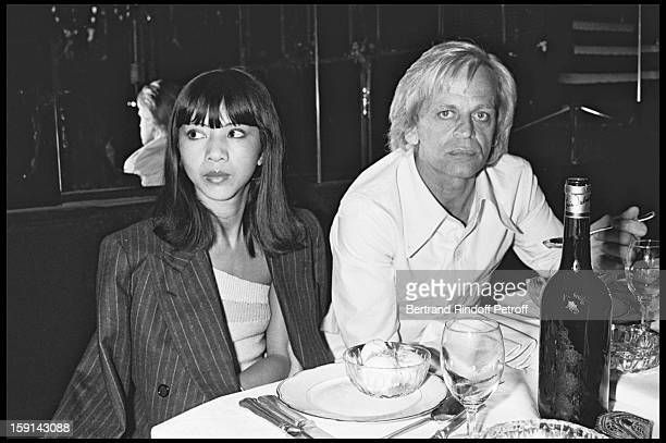 Klaus Kinski and his wife Minhoi Genevieve Loanic during a party at Elysee Matignon night club in Paris in 1977