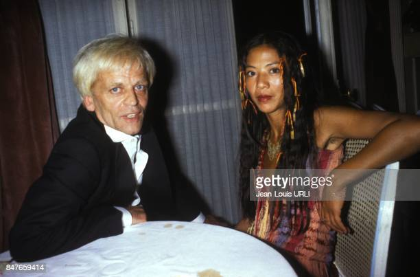 Klaus Kinski with wife Minhoi Genevieve Loanic circa 1980 in Deauville France