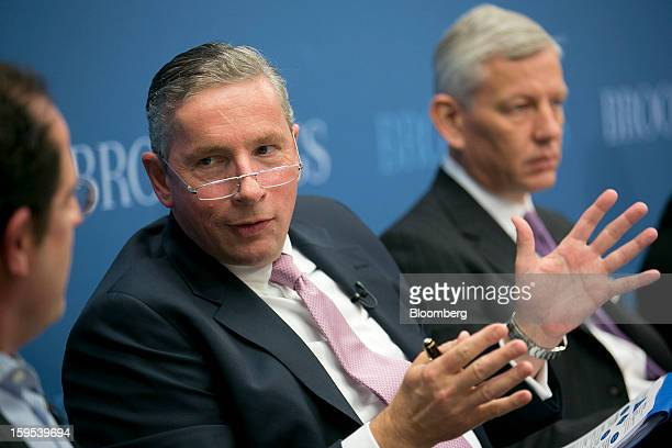Klaus Kleinfeld chief executive officer of Alcoa Inc center speaks during a panel discussion with Dominic Barton global managing director of McKinsey...