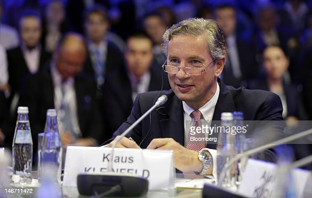 Klaus Kleinfeld chief executive officer of Alcoa Inc listens during a conference session on day three of the Saint Petersburg International Economic...