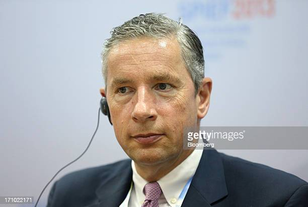 Klaus Kleinfeld chief executive officer of Alcoa Inc listens to a speech translation during a news conference on day two of the St Petersburg...