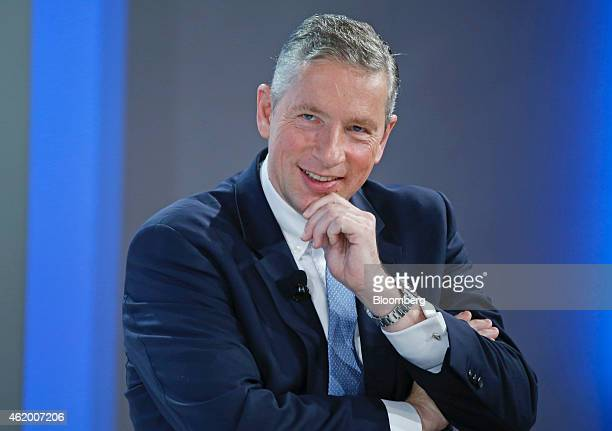 Klaus Kleinfeld chief executive officer of Alcoa Inc reacts during a session on day three of the World Economic Forum in Davos Switzerland on Friday...
