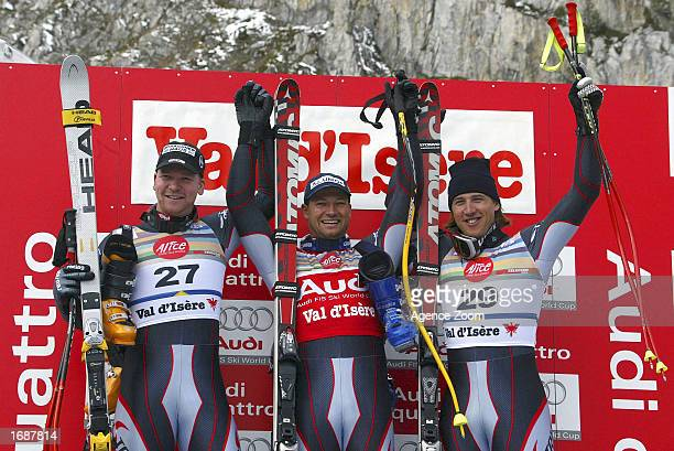 Klaus Kroell of Austria 2nd place Stefan Eberharter of Austria 1st place Andreas Schifferer of Austria 3rd place celebrate at the podium after the...