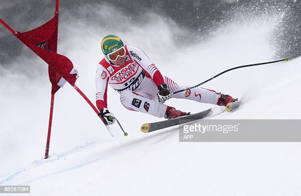 Klaus Kroell of Austria skis to clock the fastest time during the men's Alpine Skiing World Cup Downhill race, on March 7 on the Lillehammer 1994...