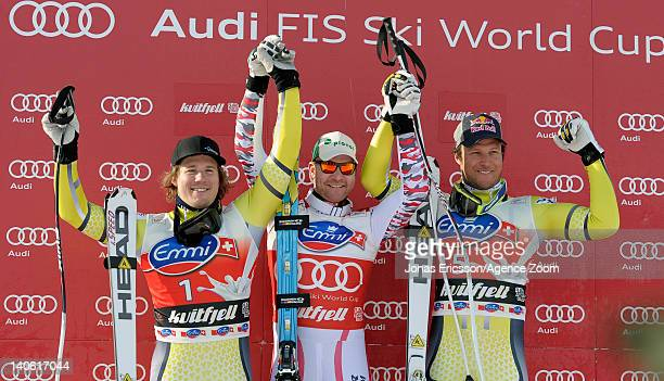 Klaus Kroell of Austria takes 1st place, Kjetil Jansrud of Norway takes 2nd place, Aksel Lund Svindal of Norway takes 3rd place during the Audi FIS...