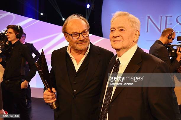 Klaus Maria Brandauer and Istvan Szabo pose for a photograph on stage during the Nestroy Award 2014 at Wiener Stadthalle on November 10, 2014 in...