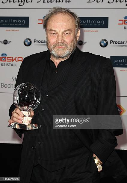 Klaus Maria Brandauer holds his award during the Steiger Award 2011 at the Jahrhunderthalle on March 12, 2011 in Bochum, Germany.