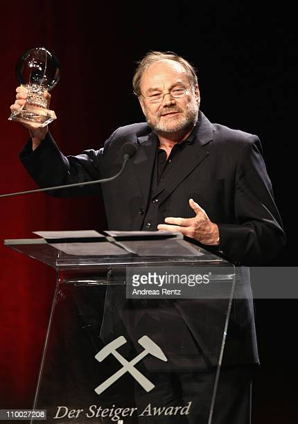 Klaus Maria Brandauer lifts up his award during the Steiger Award 2011 at the Jahrhunderhalle on March 12, 2011 in Bochum, Germany.
