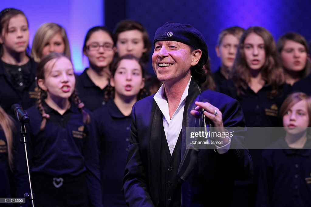 fee629a8f5bf Klaus Meine and the choir of the 'Wiener Staatsoper' perform during ...