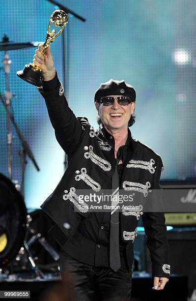 Klaus Meine of Scoprions holds his World Music Award on stage during the World Music Awards 2010 at the Sporting Club on May 18 2010 in Monte Carlo...