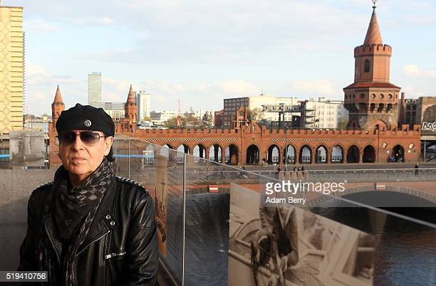 Klaus Meine singer of the band Scorpions poses in front of the Oberbaumbruecke bridge during the opening of 'The Wall Museum East Side Gallery' at...