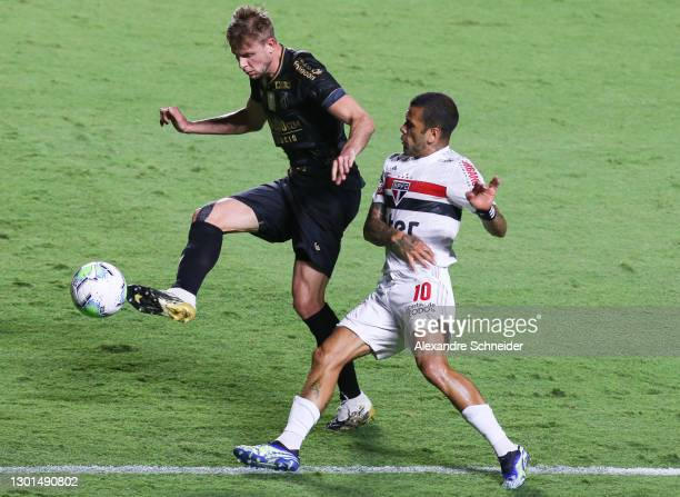 Klaus of Ceara and Dani Alves of Sao Paulo fight for the ball during a match between Sao Paulo and Ceara as part of Brasileirao Series A 2020 at...