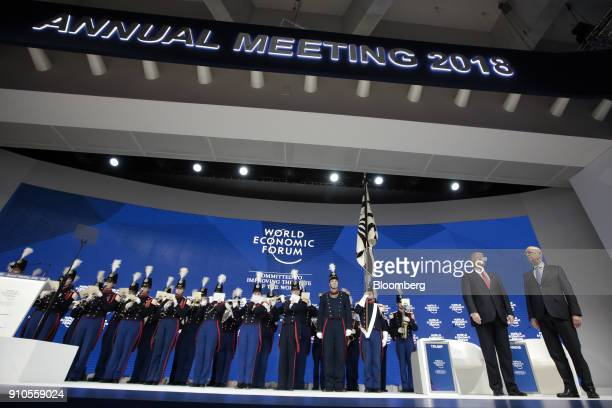 Klaus Schwab chairman of the World Economic Forum right and US President Donald Trump second right stand on stage as a band plays during a special...