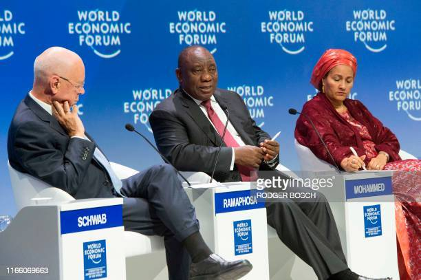 Klaus Schwab , founder of the World Economic Forum and Amina Mohammed , United Nations Deputy Secretary-General, listens to South Africa's President...