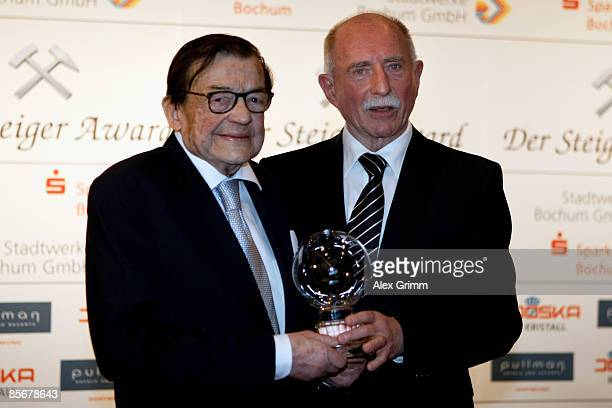 Klaus Steilmann presents his award with Werner Hansch during the Steiger Awards ceremony at the Jahrhunderthalle on March 28 in Bochum Germany