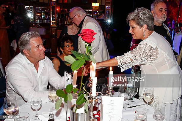 Klaus Wowereit and Dagmar Frederic attend the Udo Walz Celebrates His 70th Birthday at BAR jeder Vernunft on July 28 2014 in Berlin Germany