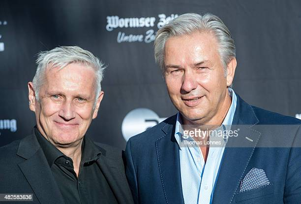 Klaus Wowereit and his partner Joern Kubicki attend the opening night of the Nibelungen festival on July 31, 2015 in Worms, Germany.