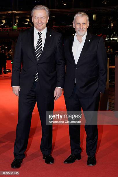 Klaus Wowereit and Joern Kubicki arrive for the closing ceremony during 64th Berlinale International Film Festival at Berlinale Palast on February...