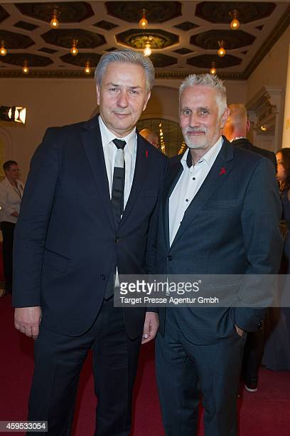 Klaus Wowereit and Joern Kubicki attend the Artists Against Aids Gala 2014 at Theater des Westens on November 24, 2014 in Berlin, Germany.