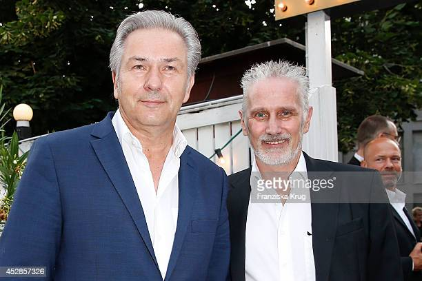 Klaus Wowereit and Joern Kubicki attend Udo Walz's 70th Birthday celebration at Bar jeder Vernunft on July 28 2014 in Berlin Germany