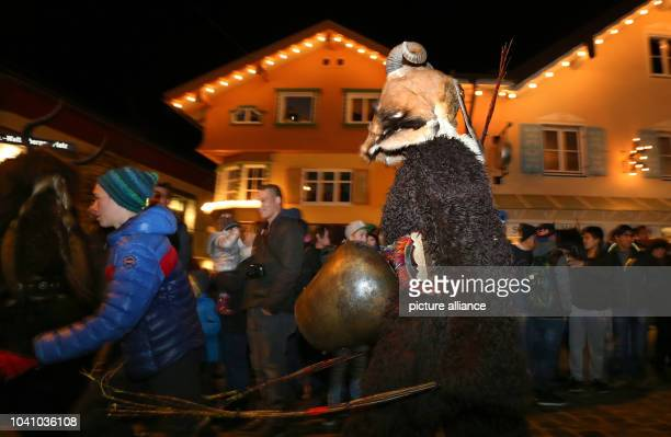 'Klausen' move through the center of Sonthofen, Germany, 05 December 2015. For the Alpine custom of 'Klausentreiben,' young men wearing masks and...