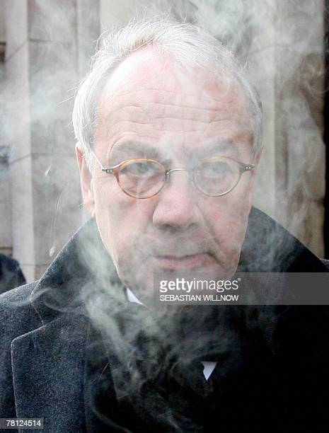 KlausJoachim Gebauer former human resources manager of Volkswagen AG smokes as he waits for the beginning of a session of his trial at a court in...