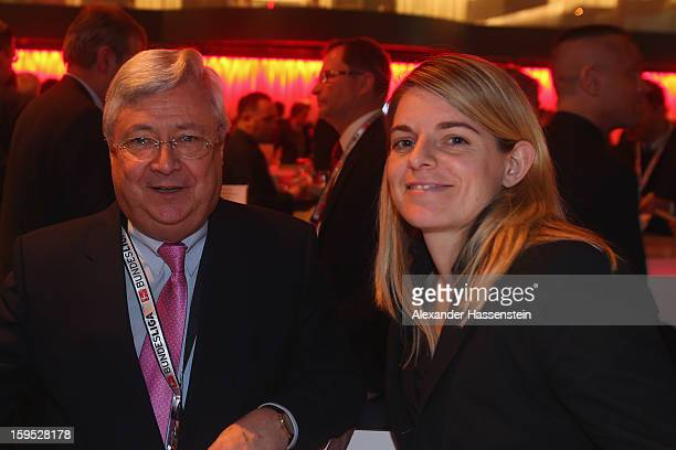 KlausPeter Mueller of Commerzbank AG and former German National player Nia Kuenzer pose during the DFL new year's reception at the Thurn und Taxis...