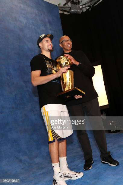 OH Klay of the Golden State Warriors poses with his father Mychal Thompson for a portrait with the Larry O'Brien Championship trophy after defeating...
