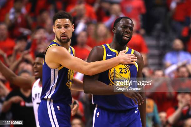 Klay Thompson and Draymond Green of the Golden State Warriors react after a foul call against the Toronto Raptors in the first half during Game Five...