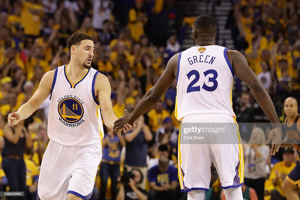 Klay Thompson #11 and Draymond Green #23 of the Golden State Warriors react after a play in Game 2 of the 2016 NBA Finals against the Cleveland Cavaliers at ORACLE Arena on June 5, 2016 in Oakland, California.