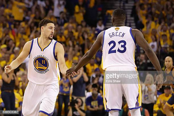 Klay Thompson and Draymond Green of the Golden State Warriors react after a play in Game 2 of the 2016 NBA Finals against the Cleveland Cavaliers at...