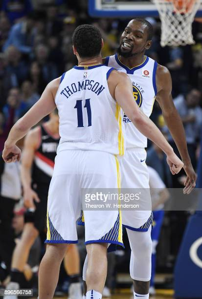 Klay Thompson and Kevin Durant of the Golden State Warriors chest bump after Thompson made a threepoint basket against the Portland Trail Blazers...