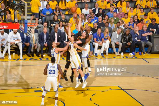 Klay Thompson and Kevin Durant of the Golden State Warriors go up for a rebound against Kevin Love of the Cleveland Cavaliers in Game Two of the 2017...