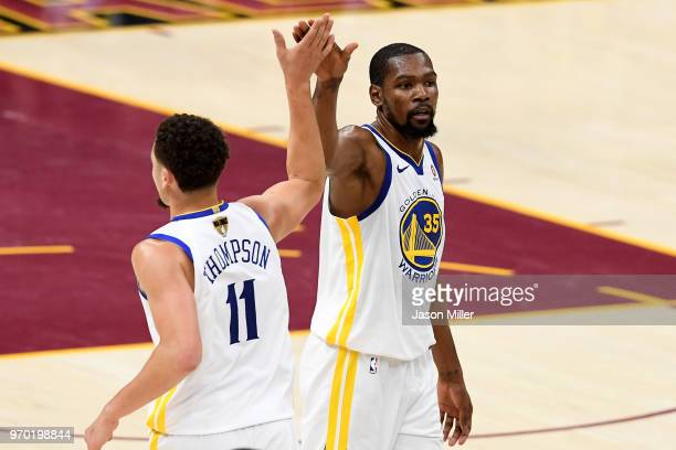 Klay Thompson and Kevin Durant of the Golden State Warriors react after a play in the second half against the Cleveland Cavaliers during Game Four of...