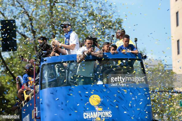 Klay Thompson and Matt Barnes of the Golden State Warriors celebrates winning the 2017 NBA Championship during a parade on June 15 2017 in Oakland CA...