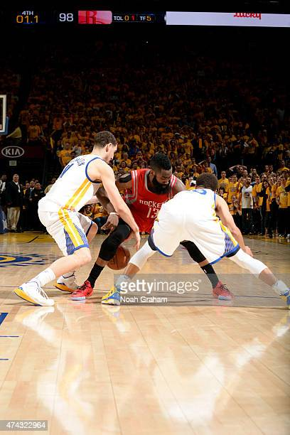 Klay Thompson and Stephen Curry of the Golden State Warriors guard against James Harden of the Houston Rockets to win the game in Game Two of the...