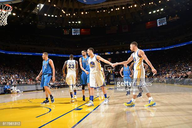 Klay Thompson and Stephen Curry of the Golden State Warriors high five during the game against the Dallas Mavericks on March 25 2016 at Oracle Arena...