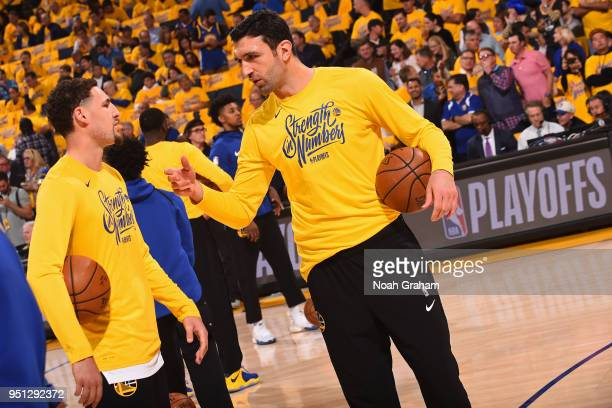 Klay Thompson and Zaza Pachulia of the Golden State Warriors warm up prior to Game Five of Round One of the 2018 NBA Playoffs against the San Antonio...